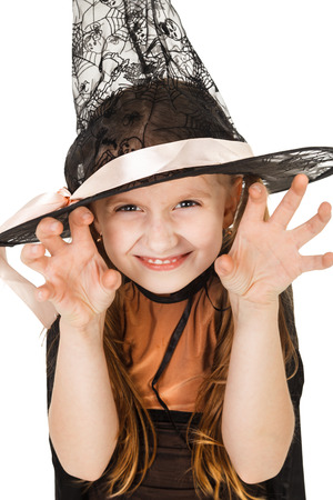 halloween kids: little girl in a witch costume Stock Photo