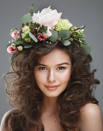 Stubio beauty portrait of cute young girl with flower crown