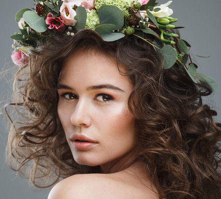 summer beauty: Stubio beauty portrait of cute young girl with flower crown
