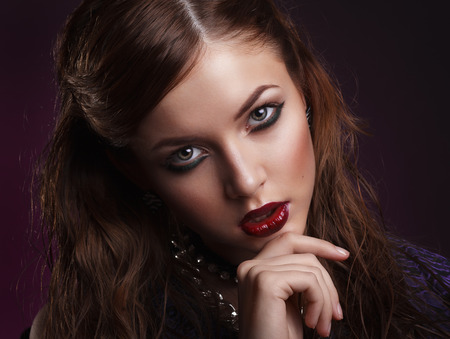 coloring lips: Beauty portrait of young brunette model with creative makeup Stock Photo