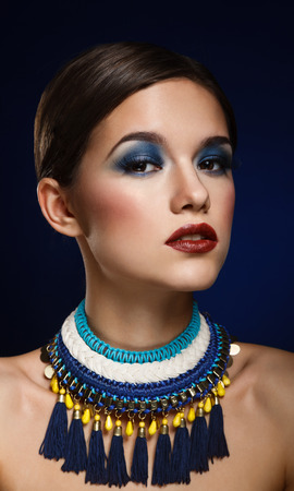 coloring lips: Fashion art portrait of beautiful woman with bright make up. Vogue Style Woman.
