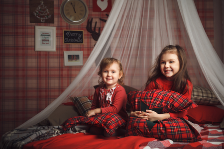 baby open present: Two little girls on bed in scottish style