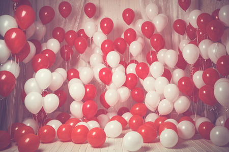 White and red balloons background. Vintage style. Фото со стока