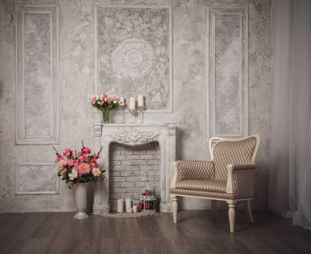 fretwork: Interior with grey fretwork background, fireplace and flowers.