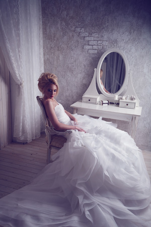 bride dress: Studio portrait of beautiful young bride in white dress. Perfect make-up and hairstyle
