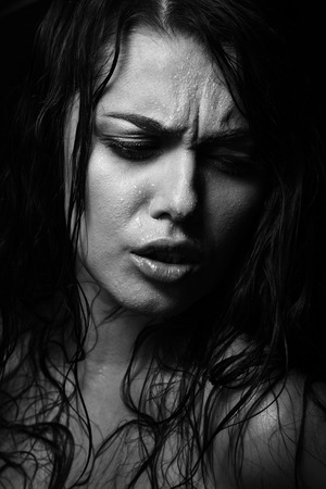 wet woman: Wet woman portrait with water drops on the face. Black and white