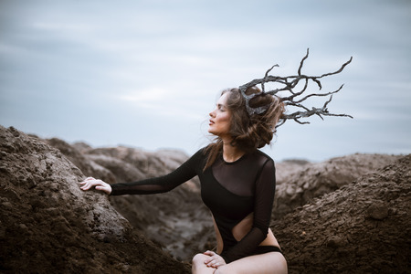 alien landscape: Portrait of young beauty woman with wooden crown. Alien landscape.