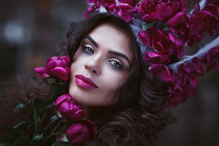 amaranthine: Beautiful woman with crown holding purple peonies.