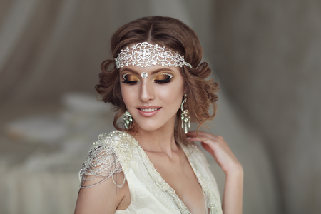 Studio portrait of beautiful bride with perfect hairstyle and makeup Stock Photo