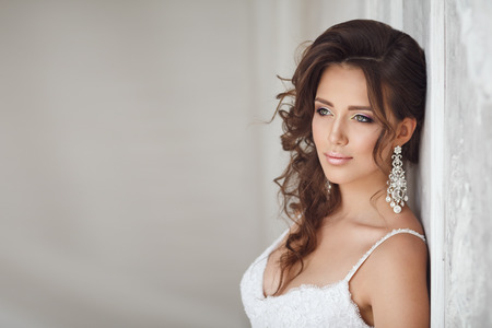 the caucasian beauty: Studio portrait of beautiful bride with perfect hairstyle and makeup Stock Photo