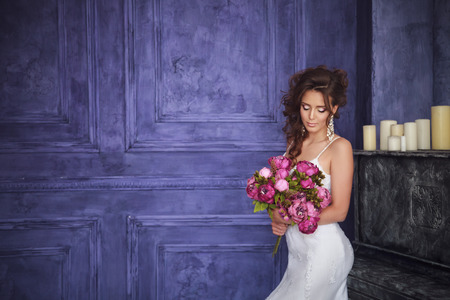 diamond candle: Studio portrait of beautiful bride with perfect hairstyle and makeup Stock Photo