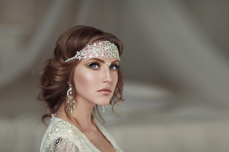 Studio portrait of beautiful bride with perfect hairstyle and makeup Фото со стока