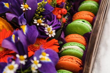 flower box: Autumn flower box with macaroons on white background Stock Photo