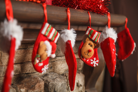 mantel: Christmas red stocking hanging from a mantel or fireplace, decorated for Stock Photo