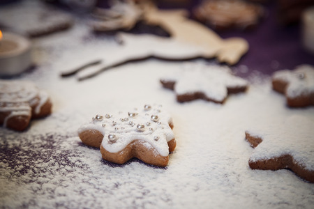 Christmas gingerbread cookie tree with flour on purple background