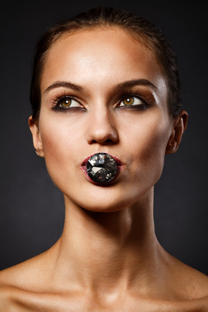 portait: Studio portait of woman with smoky make-up. Grunge style. Stock Photo