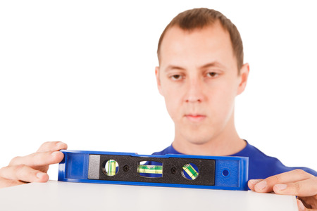 Man with tool level isolated in white background