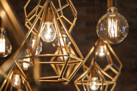 chandelier background: Incandescent retro lamps in a modern style. Edison lamp. Stock Photo
