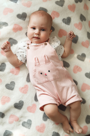 Portrait of cute baby girl in her room.