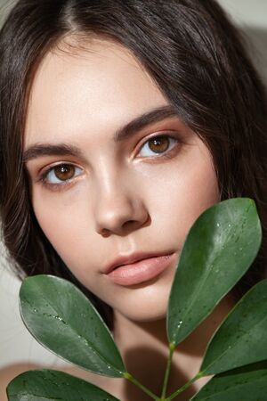 Fashion photo of young woman with natural makeup Standard-Bild - 143294634