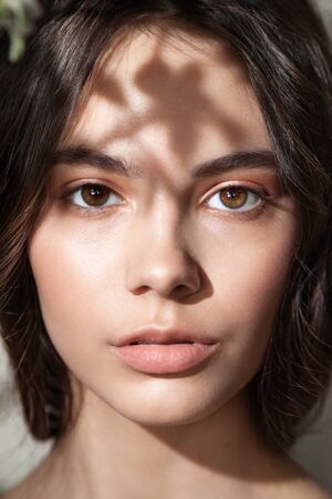 Fashion photo of young woman with natural makeup Standard-Bild - 143294635