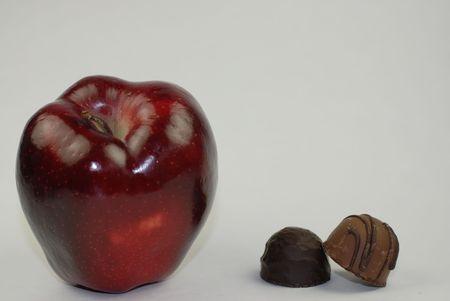 red apple & candy Reklamní fotografie