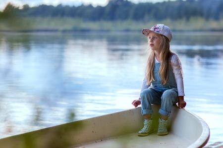 soltería: cute girl preschooler summer evenings resting on the lake
