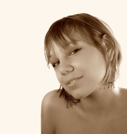 smiling girl face over the light background (sepia) Stock Photo - 727245