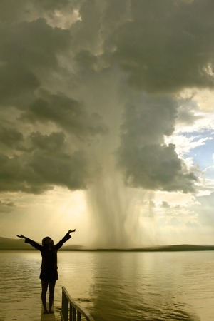 the begining of the tornado and girl silhouette Stock Photo - 1534985