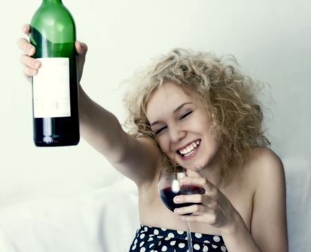 the pretty girl with wine bottle photo photo