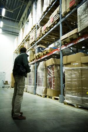 men in big warehouse photo photo
