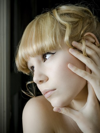 Young woman gazing out a window photo photo