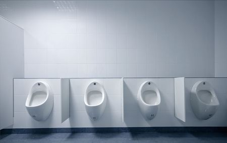 urinal: modern restroom interior photo with urinal row  Stock Photo