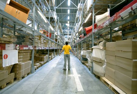storage compartment: man in big storehouse
