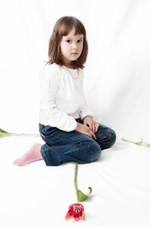 little girl, sitting on the floor & red flower Stock Photo - 5851570