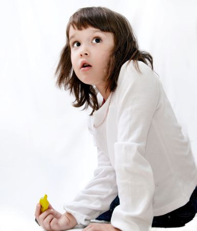 little girl with color pen, sitting on the floor Stock Photo - 5851569