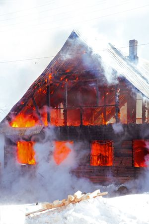 home destruction: fire in the winter country house photo