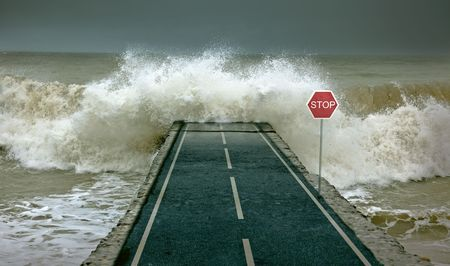 the flood tide: Huge waves, covering highway Stock Photo