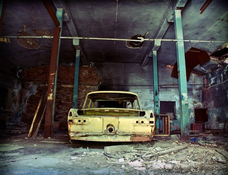 or rust: old ruined garage interior with old car