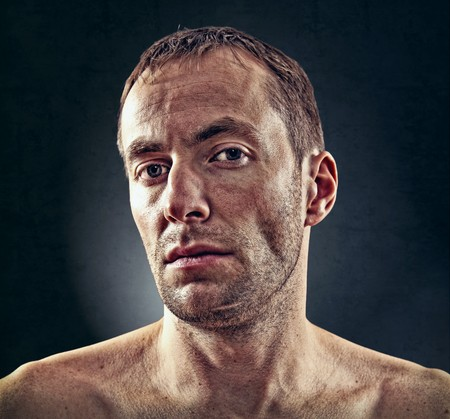 portrait of rough face  man over dark background Stock Photo - 7733628