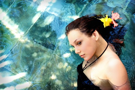 beautiful young woman on the water surface photo