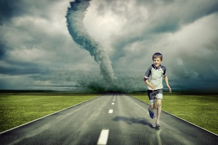 hurricane disaster: large tornado over the road and running boy ( photo and hand-drawing elements combined)