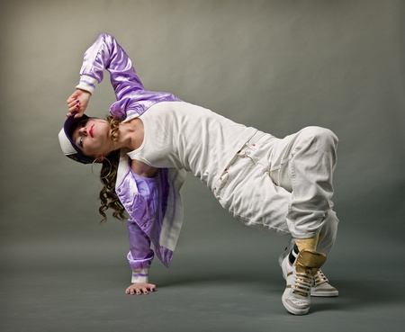 street dance: Young, beautiful  girl dancing hip-hop studio series Stock Photo
