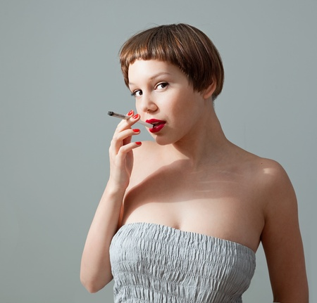 young  smoking woman studio photo Stock Photo - 10371317