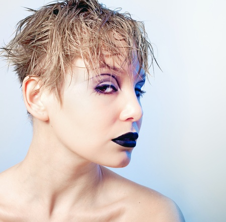 glam rock: Portrait of young beautiful freaky girl with  stylish makeup