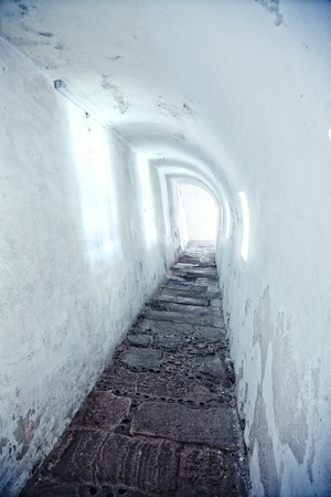 tunnel in the castle wall of the old Spanish fortress photo