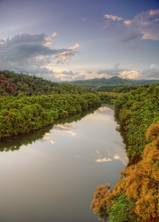 beautiful sunset over tropical river photo