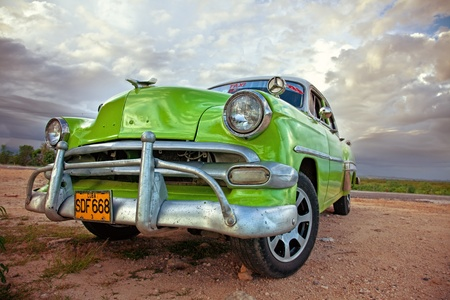 crumbling: A view of  classic vintage car, Cuba  Editorial