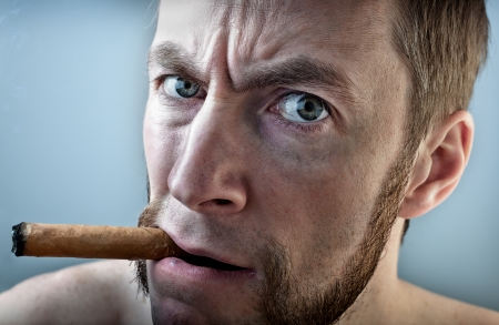 a man with a cigar, looking into the camera Stock Photo - 13875823