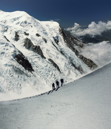 Climbers silhouette in massif de mont Blanc on the border of France and Italy  alps